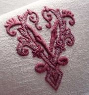 embroidered red monogram vu