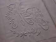 a large embroiderd monogram m  eraly 20th c.